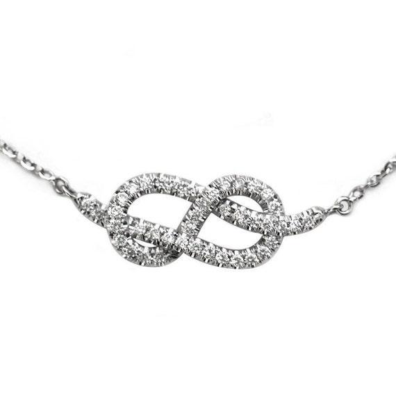 infinity knot necklace pendant by sillyshinydiamonds