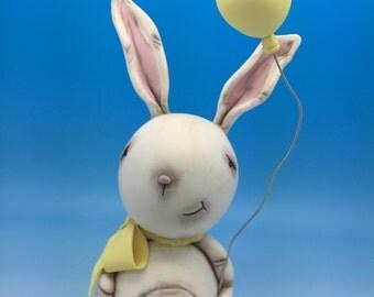 Handmade  cold porcelain  bunny figurine .
