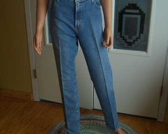 "Ladies Vintage Levi Jeans, ""Levi Strauss & Co."", Classic Relaxed Tapered 550, High Waisted Faded Denim Blue Jeans, Size 12 L, 1992-93"