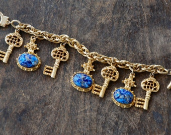 Vintage Chunky Charm Bracelet Egyptian Blue Scarab Skeleton Keys Dangling Charms Gold Tone Chain 1960's // Vintage Costume Jewelry