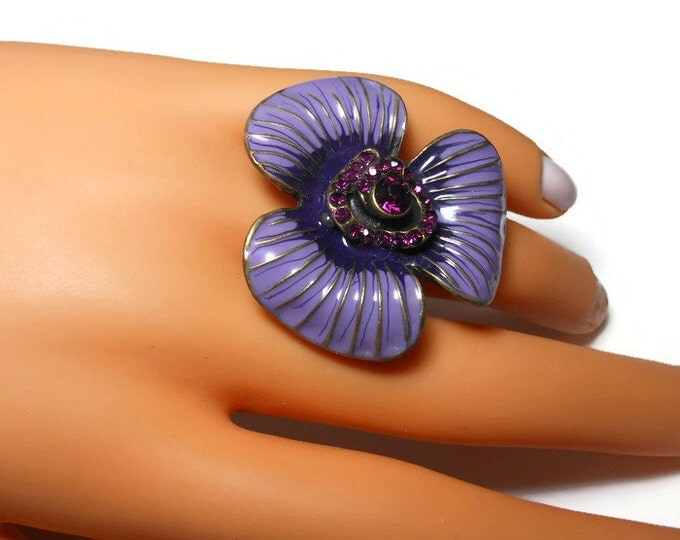 Large flower cocktail ring, purple enamel petals, gold veins, amethyst rhinestone center surrounded by pave rhinestones, stretch floral