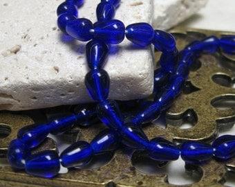 7x5mm Czech Glass Teardrop Beads in Sapphire.  3 dz.