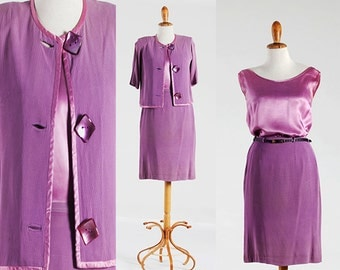 Suit an incredibly chic vintage skirt, blouse and jacket, suit from the late 1950s / early 1960s by HGHT fashion.