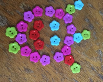 27 flower plastic buttons in different colours