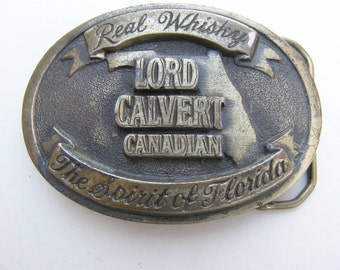 """Vintage Lord Calvert Canadian Real Whisky """"The Spirit of Florida"""" BELT BUCKLE Advertising Piece"""