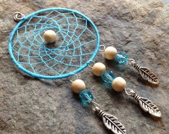 Teal Dream Catcher Pendant With Natural Wood Beads and Tibetan Silver Feather Charms