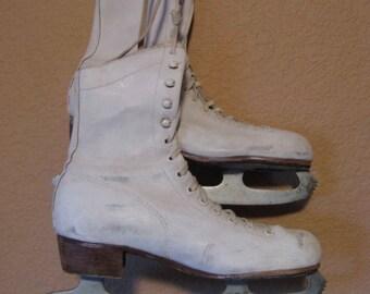vintage white ice skates or figure skates for winter or Christmas decor.