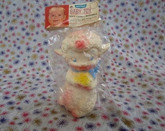 Edward Mobley, Lamb holding a bouquet, in original packaging, 1954, Squeak toy. Playful Pets. Arrow rubber and plastics.