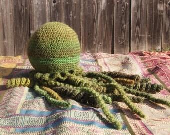 Fuzzy green amigurumi jellyfish