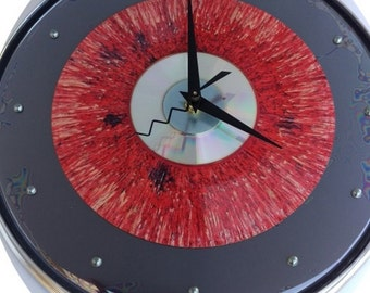 "10"" Remo Drum Skin & Hoop Clock w/ 'Rare' Spun colored 45 record and a Cd."