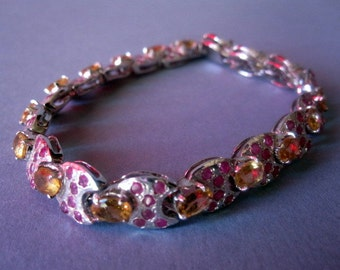 Awesome silver topaz and rubi India bracelet.