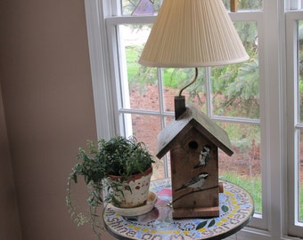Weathered birdhouse lamp with chickadees