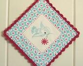 recreate a blue bird embroidered pot holder
