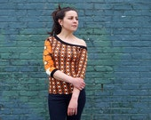 New, handmade, off shoulder asymmetrical top, 3 4 sleeve. Funky print in orange, cream, brown and black. Casual, party shirt for her, OOAK.