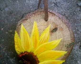 Christmas ornament  featuring a sunflower on a wood slice