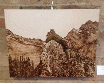 Getting The Shot Pyrography and Pencil Crayon on Birch Wood Panel