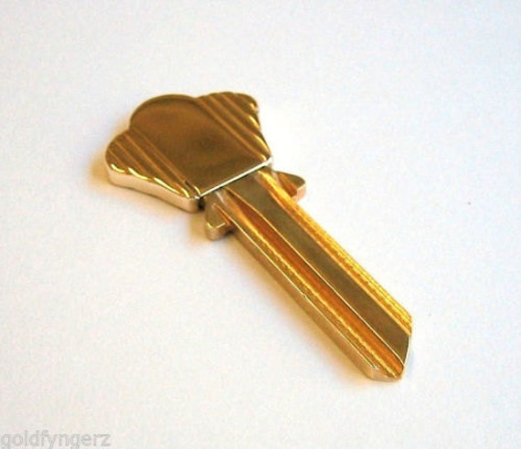 10K Yellow Gold and  Brass, Blank House Key...Made by ...Birks & Co.