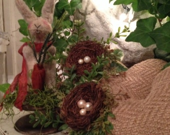 Burlap heart with nest and greenery
