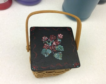 Wicker Basket has Wood hinged lid with Geraniums painted on top
