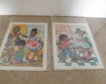 Two Black American Litho Prints