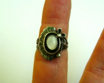 mother of pearl sterling ring, signed A Cadman, size 5.5