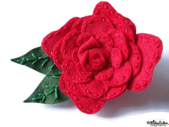 Roses are red handmade embroidered felt rose flower