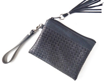 Black leather wristlet, leather clutch in lacey look leather.