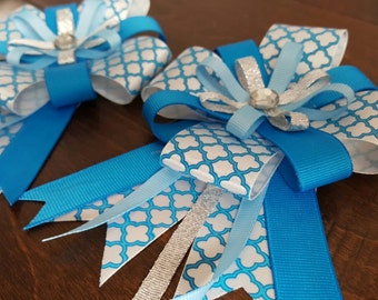 Horse show bows in trendy teal quarterfoil print with coordinating colors and bling