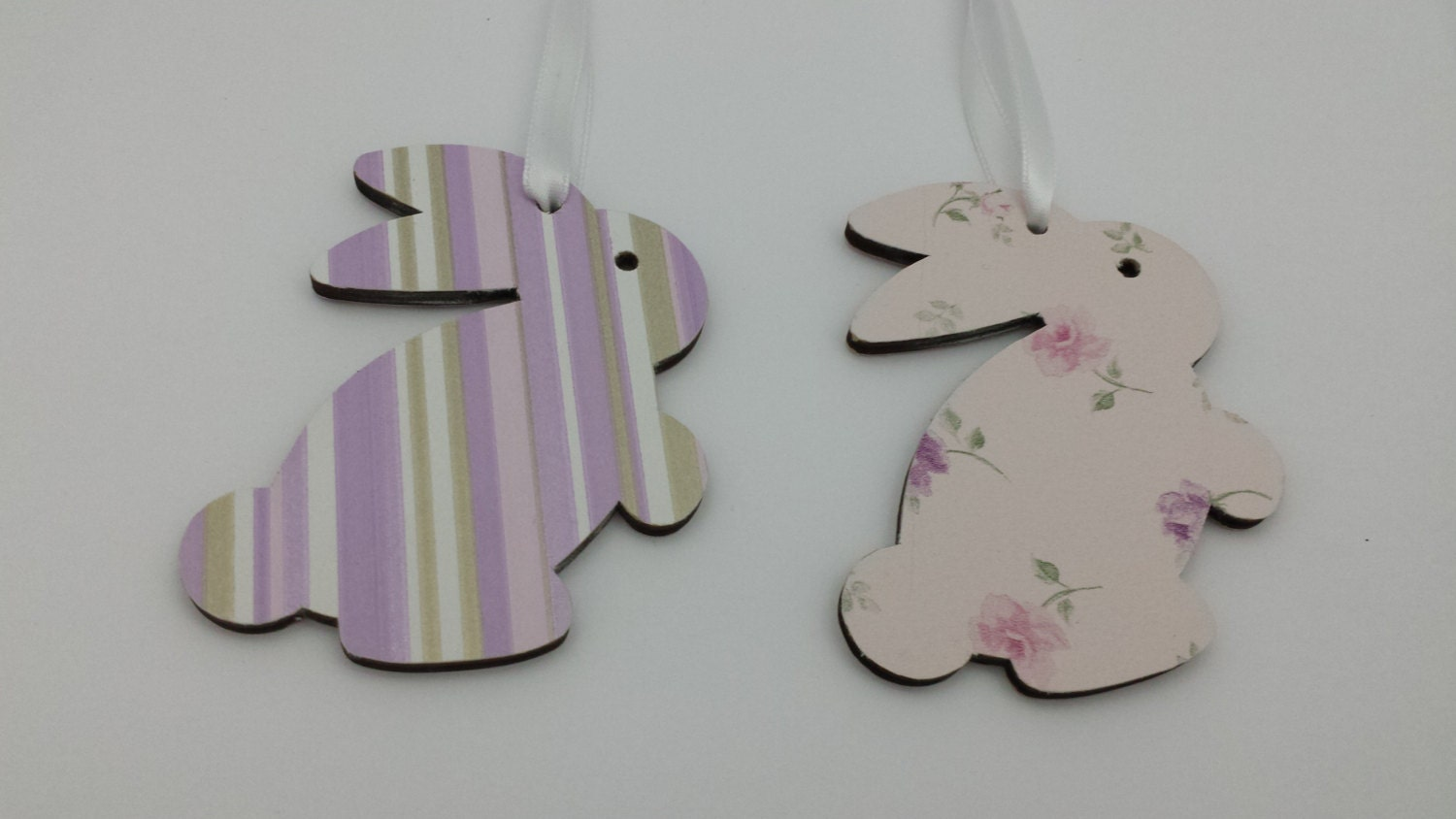 Beautifully decoupaged wooden hanging Easter bunnies.