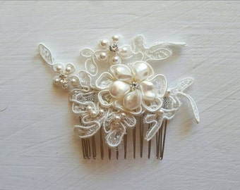 A beautiful ivory lace and pearl bridal hair comb wedding