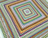 Hand made crocheted baby blanket in bright colours