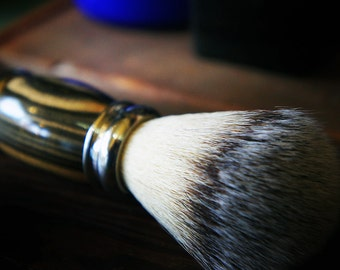 Silver tipped badger shaving brush in black and white ebony wood.