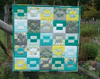Baby Quilt- Contemporary quilt with teal, aqua, gray, yellow and white cotton fabrics. Machine wash and dry.