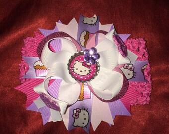 Hello kitty bow on headband Hello Kitty bottle cap design