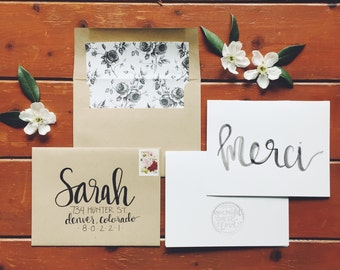 hand-lettered watercolor merci card
