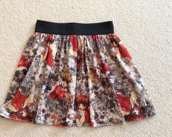 Anime Japanese Cartoon Skirt gathered onto a black elastic waistband.