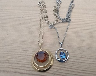 Two vintage rhinestone pendants with chains