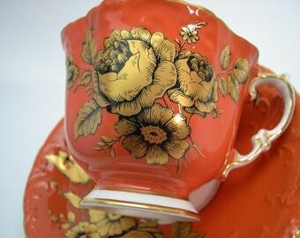 Orange Aynsley Tea Cup and Saucer,  Aynsley  Gold Roses tea cup and saucer , Adobe Orange tea cup