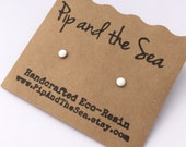 New improved waterproof design! Itty bitty, white, eco-resin studs on allergy-friendly surgical steel.