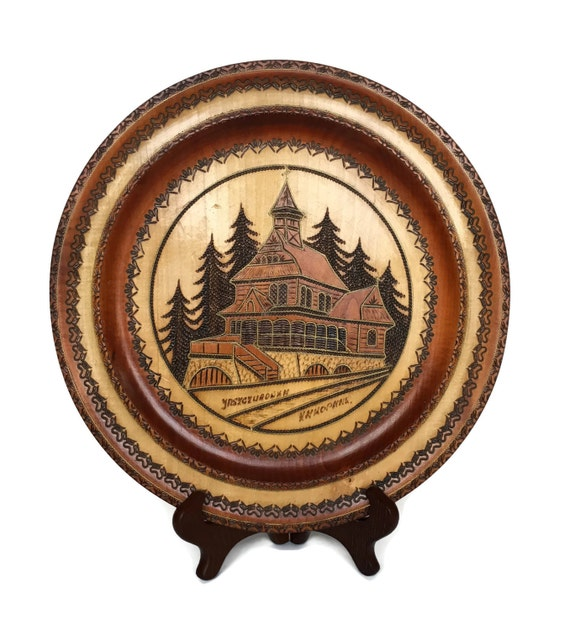 Vintage carved wooden plate intricate wood carving of home european
