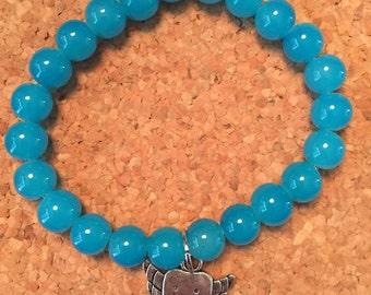 Beaded bracelet with tooth charm