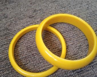 Two Yellow BAKELITE BANGLES