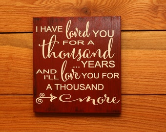 I Have Loved You For A Thousand Years sign