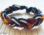 Natural braided leather bracelet with genuine Baltic amber beads