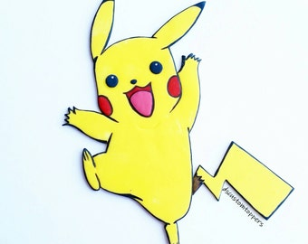 Pikachu cake topper.  Pokemon cake topper