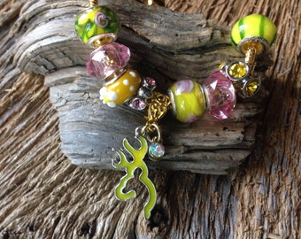 Browning yellow deer head bracelet: pink and yellow browning deer bracelet