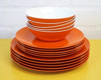 Vintage orange melamine plates and bowls