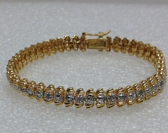 Sterling silver bracelet with white and yellow gold overlay.