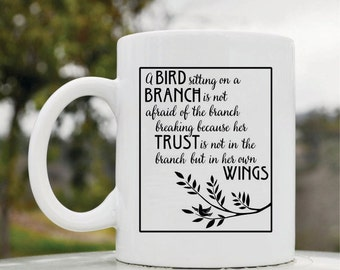 Slap-Art™ A bird sitting on a branch is not afraid of the branch breaking because her trust is not in the branch... 11oz coffee mug cup