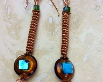 Venetian glass earring have stunning blue foil centers with copper rims and are set on copper coiled wire topped with crystals.